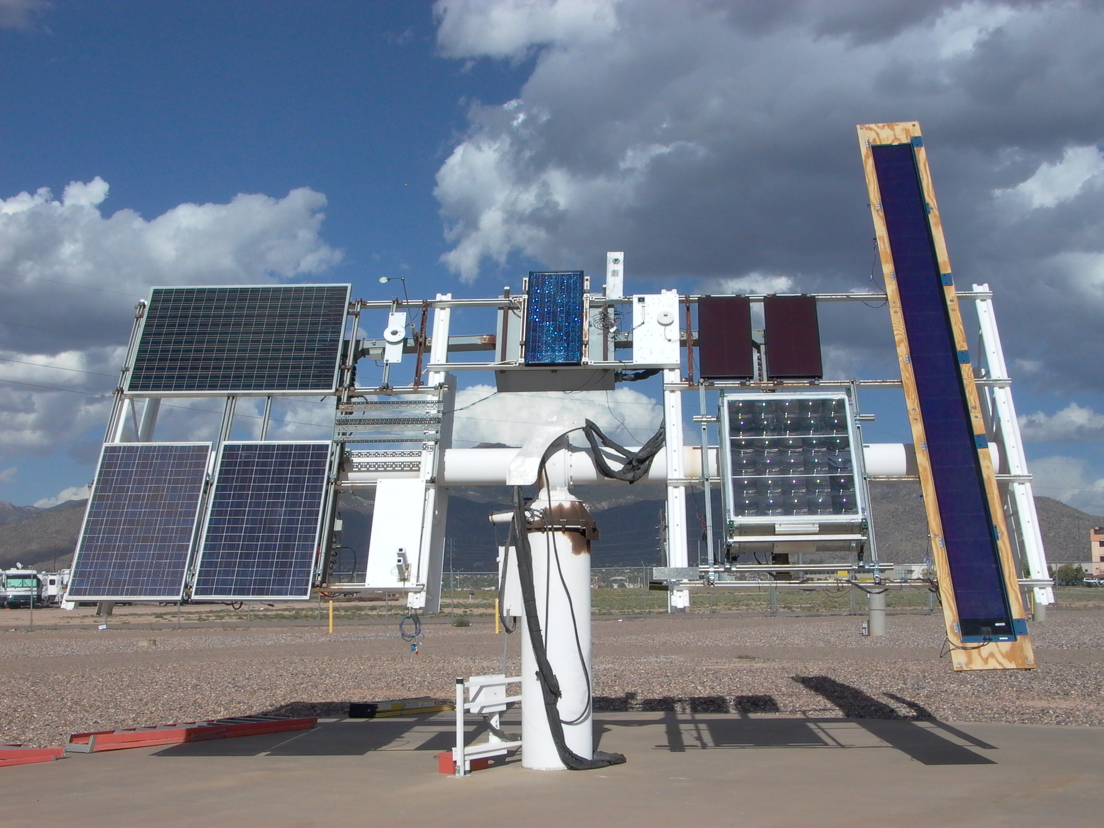 Photo of outdoor testing equipment with a variety of attached PV modules.