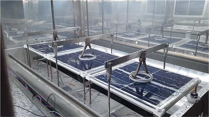 PV modules in a lab being sprayed and saturated with water