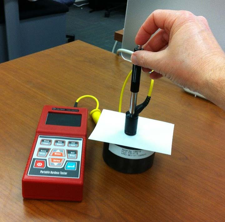 Image of a portable, rebound-indent tester being used on a polymer backsheet.